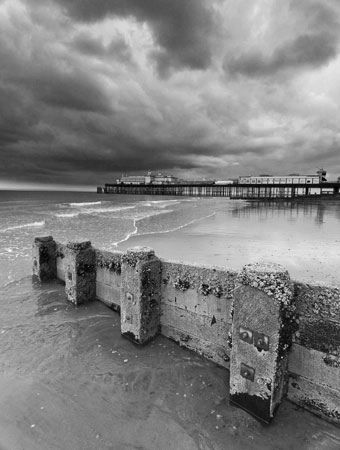 "Photograph of Hastings Pier with stromclouds by Hastings Photographer Jon ""Huldrick' Wilhelm."