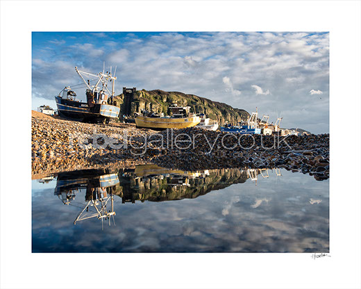 Photo of Trawlers on Hastings Stade reflected in water by Hastings photographer Jon Huldrick Wilhelm.